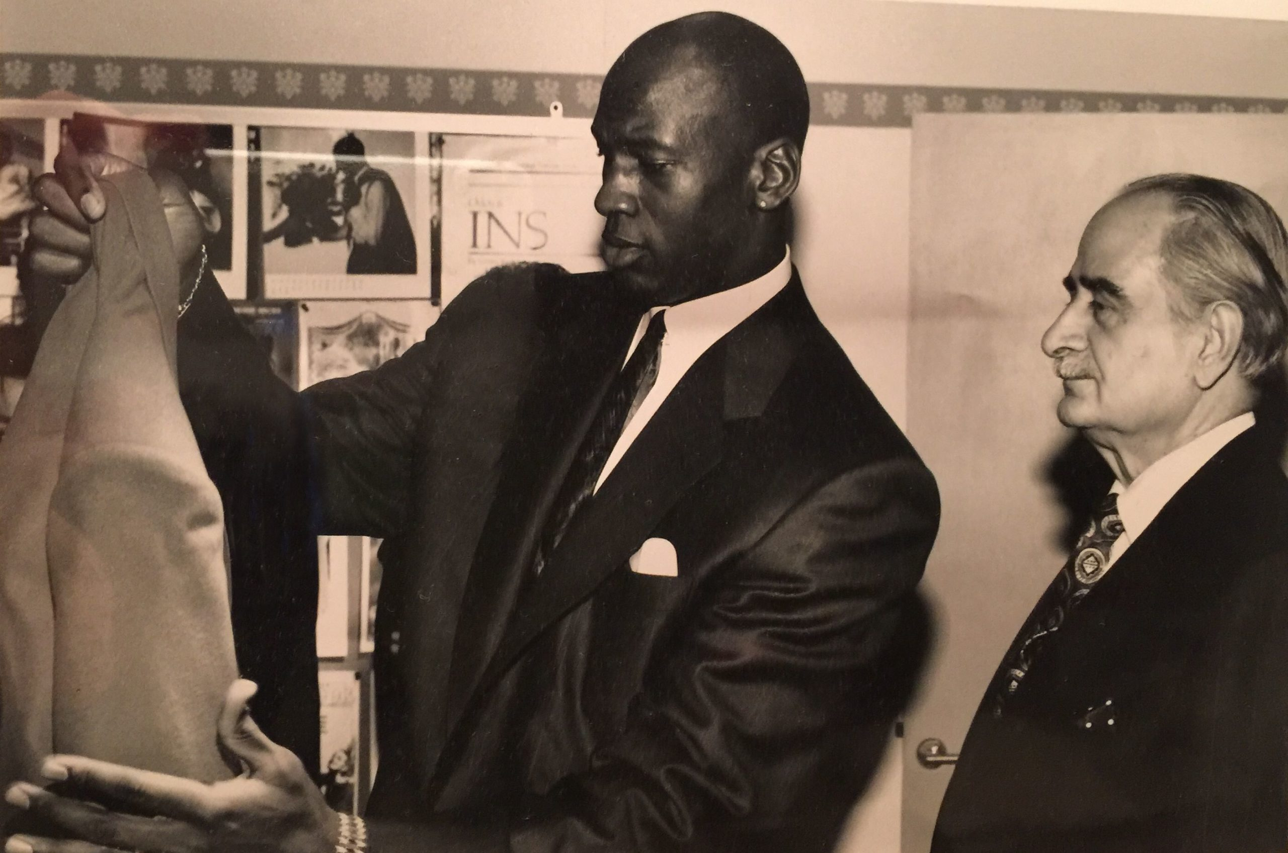 Michael Jordan picking out a suit in his younger years