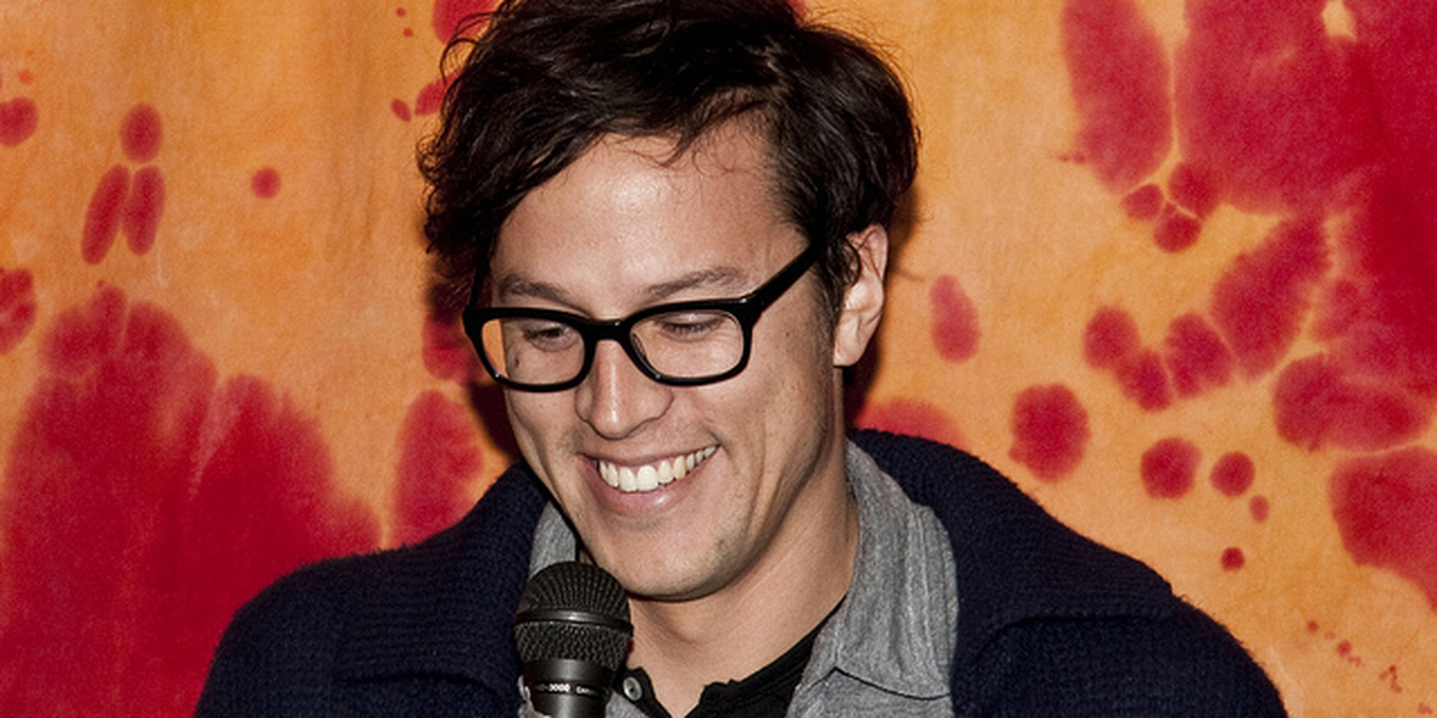Movie Director Fukunaga in front of a microphone