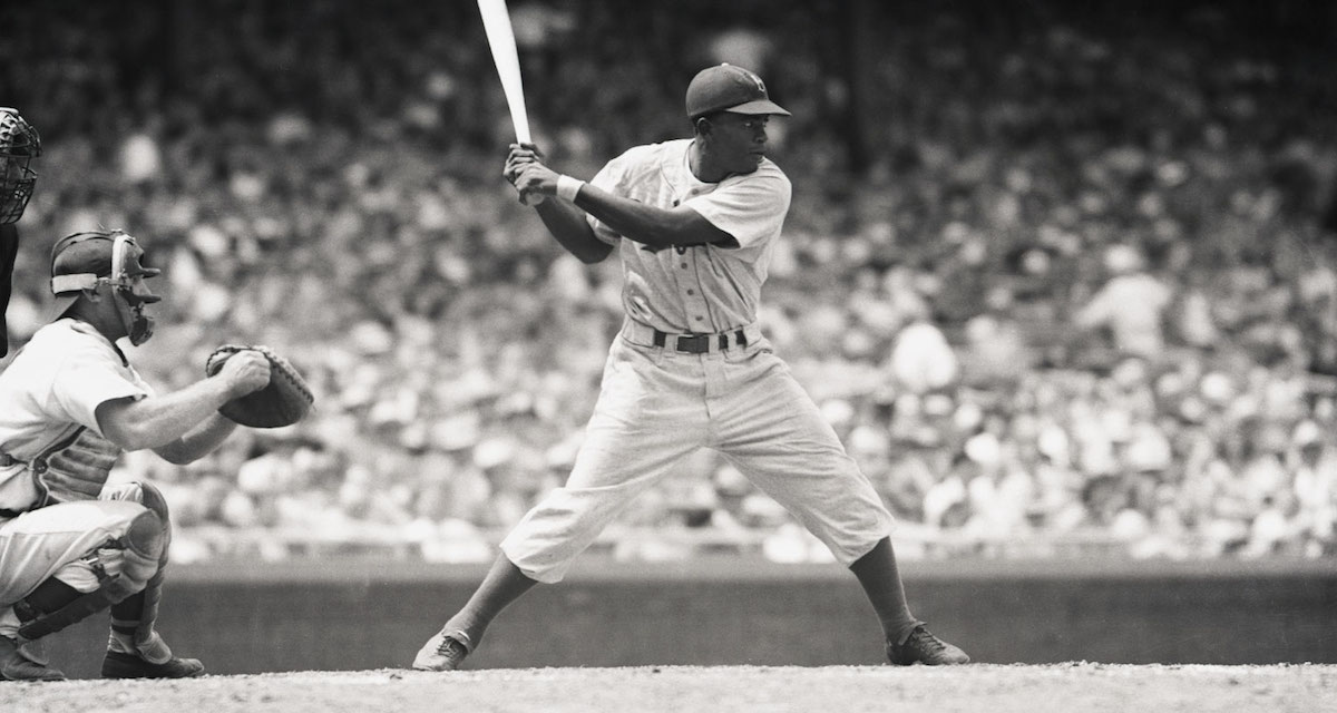 Baseball legend Jackie Robinson playing on the field; archive image