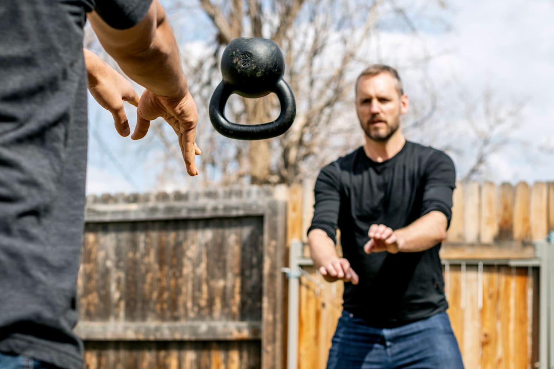 Scott Carney throwing weights