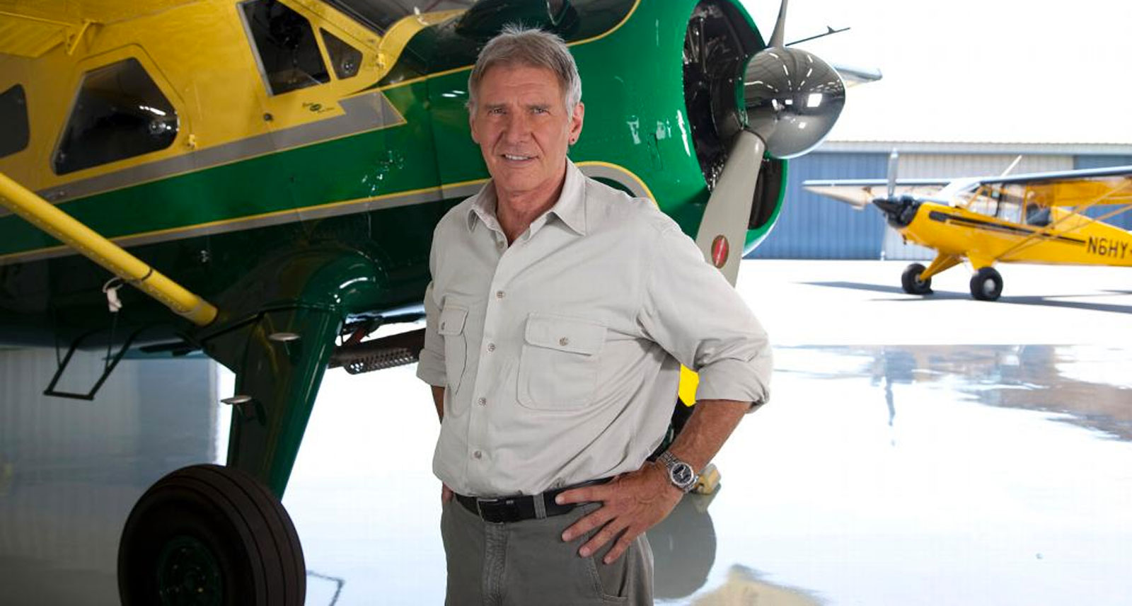 Harrison Ford next to his plane
