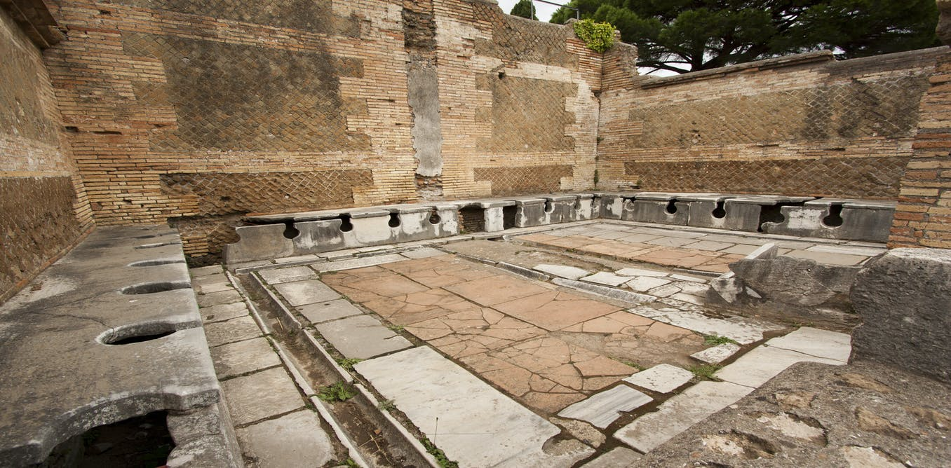 Ruins of a second-century public toilet in Roman Ostia.