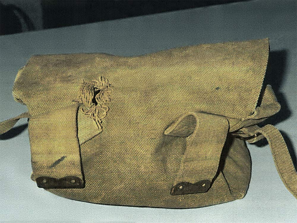 Pte. Clem Mageau's Knapsack with a bullet hole stopped by his shaving kit