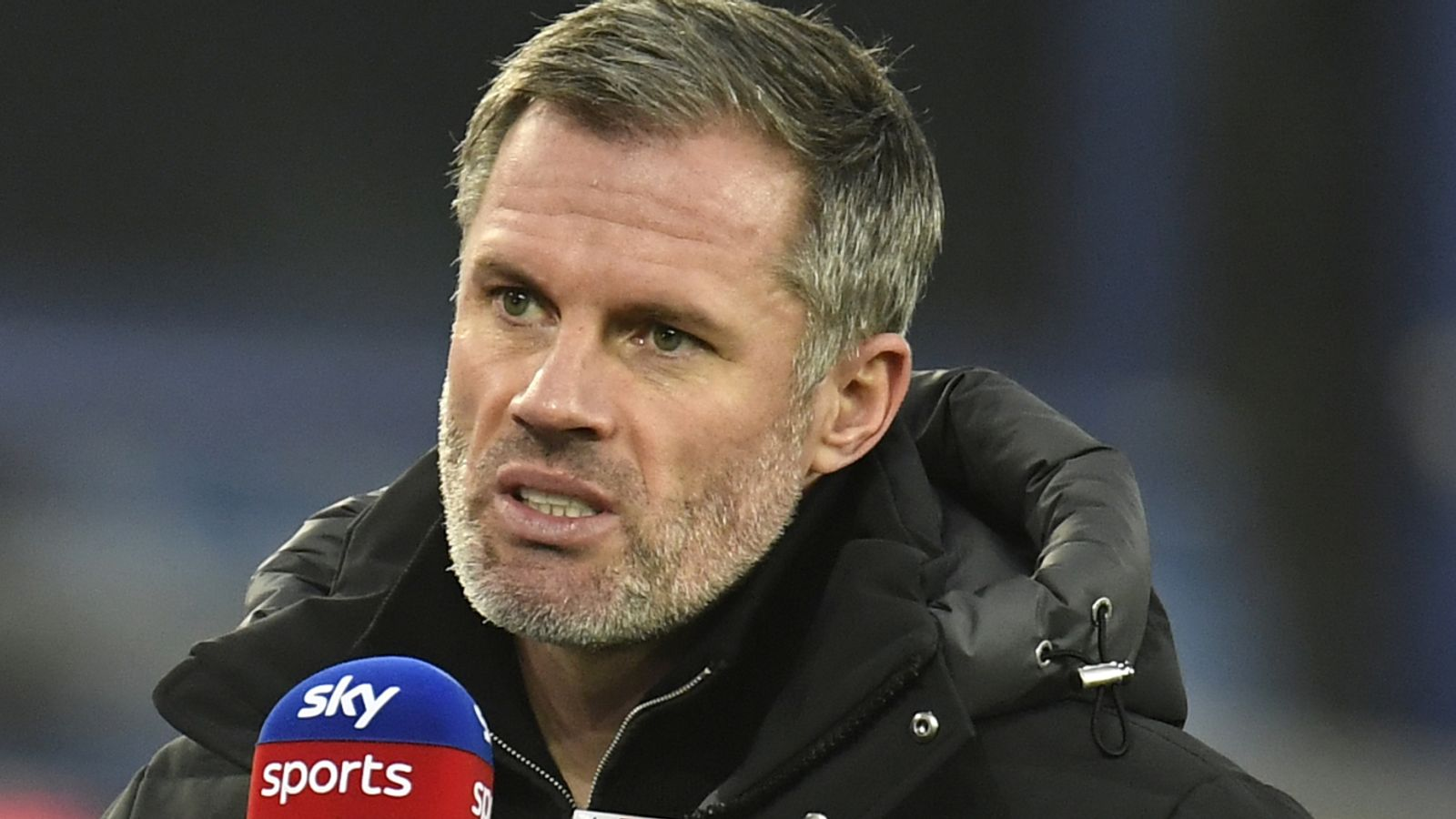 Former soccer player and pundit, Jamie Carragher giving a post-match analysis on Sky Sports.